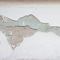 white paint pealing on the side revealing lead