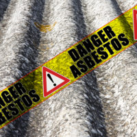 Yellow tape that reads danger Asbestos.jpg.crdownload