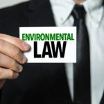 Man holding Environmental law sign