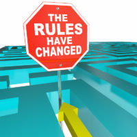 The Rules Have Changed Stop sign with puzzle maze game in background