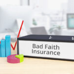 Bad Faith Insurance - Finance/Economy. Folder on desk with label beside diagrams. Business/statistics
